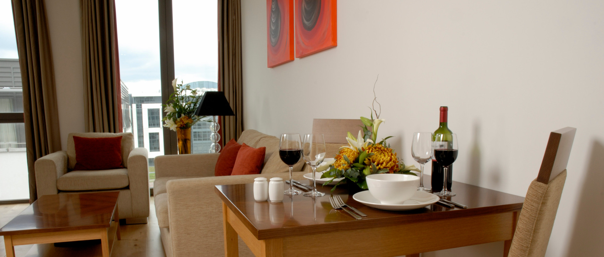 The dining table set up for dinner at PREMIER SUITES Sandyford serviced apartments